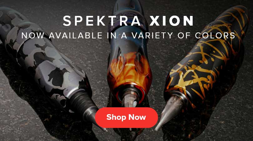 Photo of three Spektra Xion tattoo machines on black granite with the text SPEKTRA XION now available in a variety of colors Shop Now